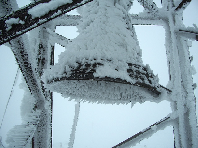 2290 m altitude. The bell at Cherni Vryh peak is all covered with ice and snow.